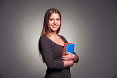 Young woman holding two books Stock Photography