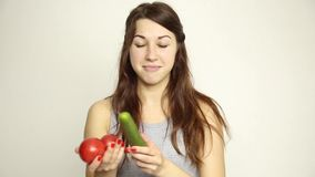 Young woman holding two tomatoes and expresses different emotions. healthy food - strong teeth concept.  stock video