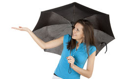 Young woman holding a umbrella, checking for rain Stock Image