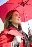 A young woman holding an umbrella, close-up Stock Images