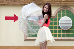 Young woman holding an umbrella. Stock Images