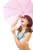 Young woman holding  a umbrella to cover the sunlight Royalty Free Stock Photo