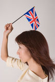 Young woman holding Union Jack. Young Asian woman holding British flag Stock Photo