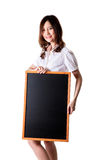 Young Woman Holding Up a black board. Studio shot Stock Photography