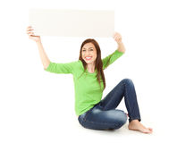 Young woman holding up blank sign above his head Stock Photos