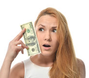 Young woman holding up cash money of one hundred dollars in hand. Worrried nervous isolated on a white background Royalty Free Stock Photo