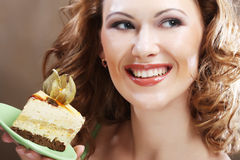 Young woman holding up a delicious piece of cake Royalty Free Stock Image