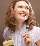 Young woman holding up a delicious piece of cake Royalty Free Stock Photography