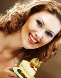 Young woman holding up a delicious piece of cake Royalty Free Stock Photo