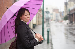 Young woman holding up her umbrella Royalty Free Stock Photo
