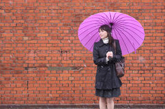 Young woman holding up her umbrella Stock Photos
