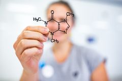 Young woman holding up a molecular model royalty free stock image
