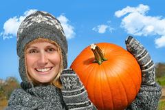 Young woman holding up a  pumpkin Stock Photo