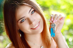 Young woman holding up a set of keys Royalty Free Stock Image