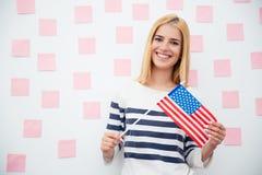 Young woman holding USA flag Stock Photography