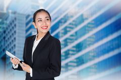 Young woman holding using touch pad tablet computer, model is a asian. Beauty Stock Photography