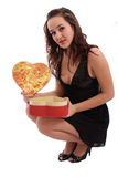 Young woman holding Valentine's Day gift box Royalty Free Stock Images