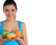 Young woman holding various fruits Royalty Free Stock Photography