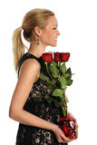Young Woman Holding Vase with Roses Stock Images