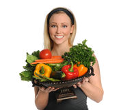 Young Woman Holding Vegetable Bowl Stock Photography