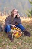 Young woman holding vegetables basket Royalty Free Stock Photo