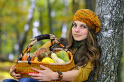 Young woman holding vegetables basket outdoor Royalty Free Stock Photos