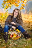 Young woman holding vegetables basket outdoor Stock Photo