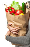 Young woman holding vegetables and fruits in shopping bag Royalty Free Stock Image