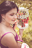 Young woman holding vintage birdcage Royalty Free Stock Photo