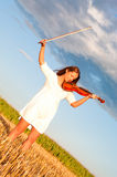 Young woman holding violin and bow Stock Photo