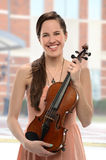 Young Woman Holding Violin Royalty Free Stock Photos