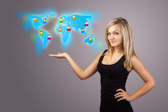 Young woman holding virtual map Stock Photo