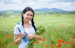 Young woman holding water bottle Royalty Free Stock Photo