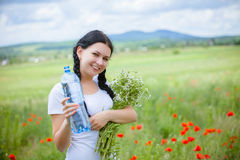 Young woman holding water bottle Royalty Free Stock Photos