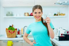 Young woman holding water glass. Stock Photos
