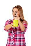 Young woman holding a watering spray bottle Royalty Free Stock Photo