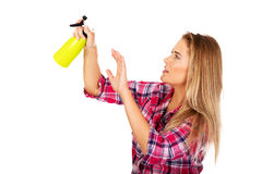 Young woman holding a watering spray bottle Stock Images