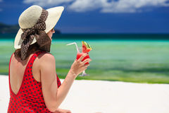 Young woman holding watermelon cocktail on the beach Royalty Free Stock Image