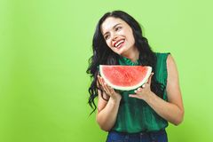 Young woman holding watermelon. On a solid background royalty free stock photos