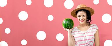 Young woman holding watermelon. On a solid background royalty free stock photography