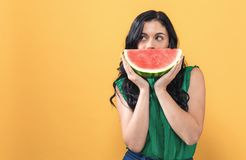 Young woman holding watermelon royalty free stock photography