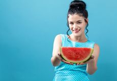 Young woman holding watermelon. On a solid background royalty free stock images