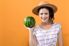 Young woman holding watermelon stock photography