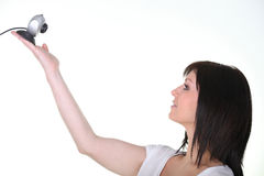 Young woman holding webcam on white background Royalty Free Stock Image