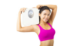 Young woman  holding  weight scale. Young woman  holding the weight scale Stock Image