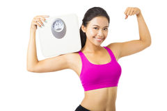 Young woman  holding  weight scale. Young woman  holding the weight scale Stock Photography