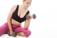 Young woman holding weights and doing fitness Stock Images