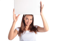 Young woman holding white board Stock Photos