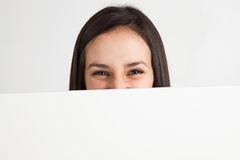 Young woman holding a white board Royalty Free Stock Images