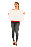 Young woman holding white board isolated over white background Royalty Free Stock Photos
